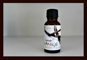 flydende vaniljekorn på glas